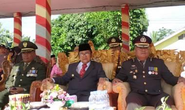 Bupati Gorontalo Utara Indra Yasin Hadiri Puncak HUT Bhayangkara Ke - 73 Di Tibawa
