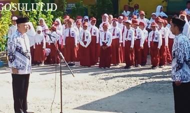 Peringati HUT PGRI- Hari Guru, SDN 10 Tilamuta Desa Bajo Gelar Upacara