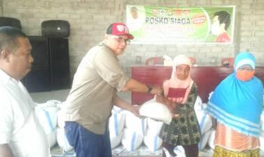 Kades Dulohupa, Hariyanto Karim Mulai Salurkan Bantuan Penanganan Covid-19