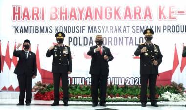 GUBERNUR RUSLI HABIBIE IKUTI UPACARA HUT BHAYANGKARA KE-74 DITITINEPO MAPOLDA GORONTALO