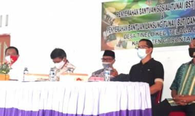 Prof. Nelson Pomalingo Tinjau Langsung Penyerahan BST Dan BLT Di Kecamatan Telaga Biru