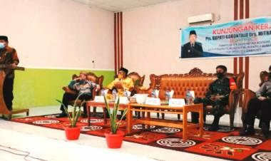 Disambut Adat Mopotilolo, Pjs Bupati Gorontalo Pastikan Penerapan Prokes Dan Demokrasi Berjalan Lancar