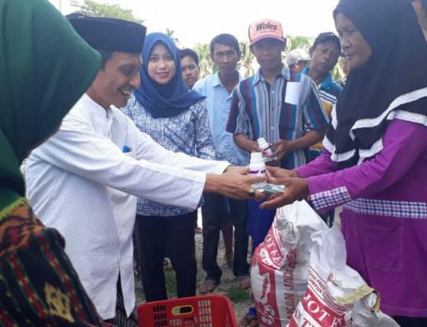 Hari Ini Nelson Pomalingo Serahkan Bantuan Di Masyarakat Kecamatan Tolangohula